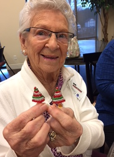 Dorothy Rafferty making earrings at a craft session at The Heritage